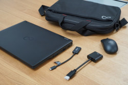 Top Case with notebook, mouse, USB C adapter, and HMDI adapter