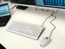 White keyboard and mouse on desk