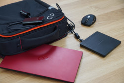 Prestige Case with Notebook, mouse, car adapter, and DVD writer