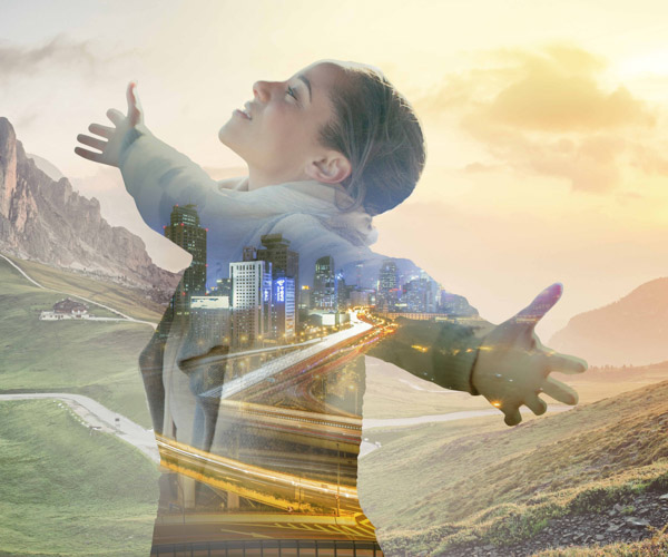 A woman stands, arms outstretched, superimposed over combined natural landscape and city scape