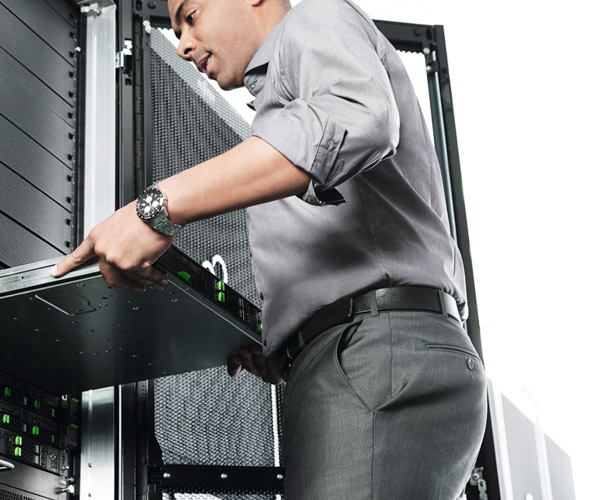 A man pulls a server out of a rack