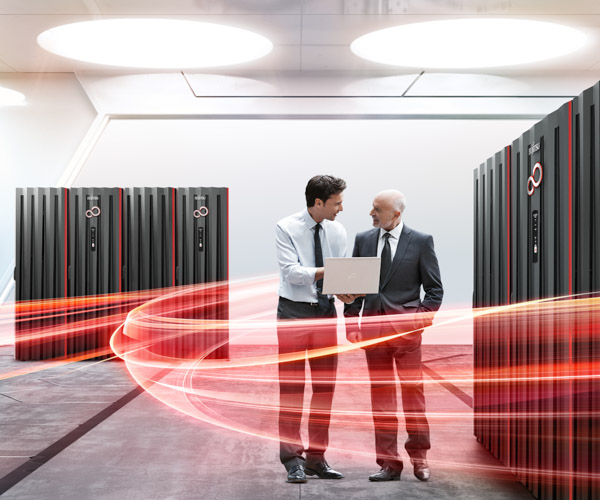 Two people in discussion in a server room, surrounded by symbolic red light trails